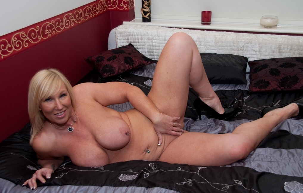Melody is the perfect British MILF with amazing 32FF tits