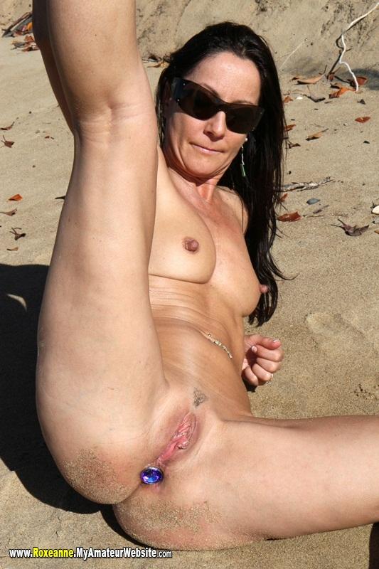 butt plug under bikini on the beach