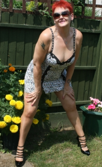 Valgasmic - Val is a cheeky british redhead who loves to dress up as your fantasy lady. Shes in her Foxy Fifties and really knows how to look after her members