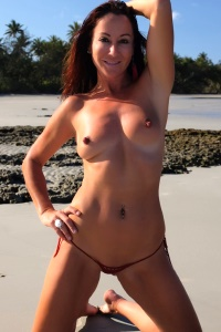Roxeanne is a stunning MILF with a pert and petite figure that she loves to show off with her extreme bikinis